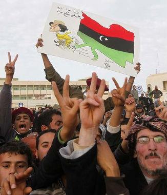 Lo que queda del régimen de Gadafi entabla negociaciones con los rebeldes del Este mientras se crea un gobierno de transición en Benghazi