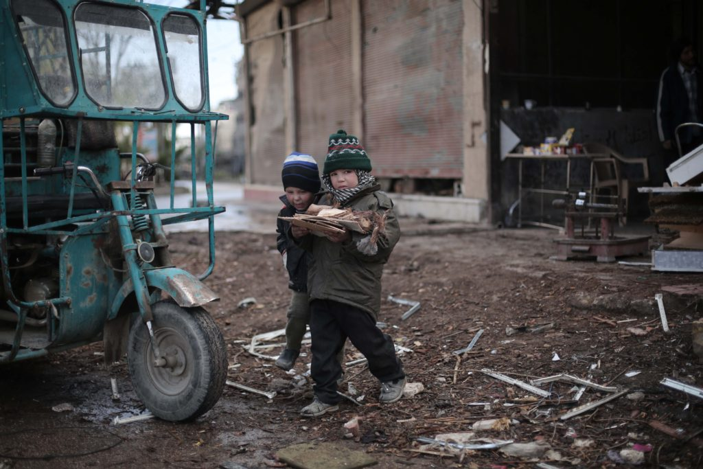 On 1 January, two boys carry chopped firewood in Kafar Batna village in Rural Damascus Suburbs.  Following almost five years of the Syria crisis, 4.5 Million people continue to live in areas- like this one- that are hard to reach for the humanitarian community. Almost 400,000 of those are besieged.  A very harsh weather conditions are amongst many difficulties that civilians have to endure to survive. UNICEF is targeting one million children throughout the country with winter supplies during the 2015/2016 winter season.   So far, winter clothing kits and blankets have reached 95,000 children while delivery and distribution is ongoing for 545,000 children.  In addition, 2,000 heaters are currently being installed in classrooms benefiting 80,000 children.