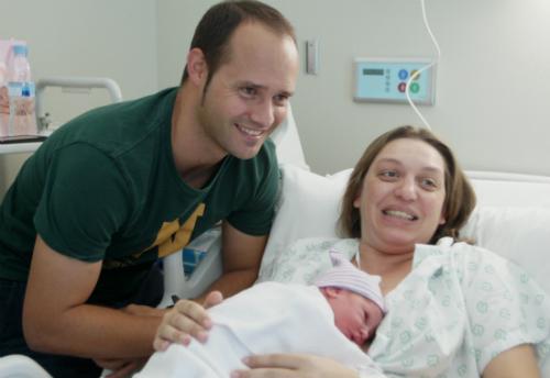 Andrea con sus padres Sandra y Pablo