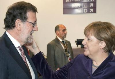 Merkel y Rajoy, en Bruselas este jueves/ Foto: Twitter