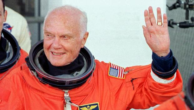 KENNEDY SPACE CENTER, UNITED STATES: US astronaut and senator John Glenn waves as he leaves the Operations and Check out building at the Kennedy Space Center, FL, 29 October in route to board the US space shuttle Discovery. The seven person crew will perform several scientific experiments during their nine day mission, including studies on the effects of weightlessness on 77-year-old Glenn. Glenn who is 77 years old will be the oldest man to fly into space. AFP PHOTO Roberto SCHMIDT (Photo credit should read ROBERTO SCHMIDT/AFP/Getty Images)